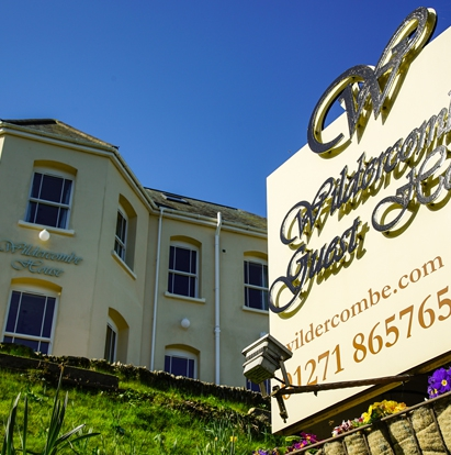 Wildercombe House and sign